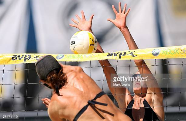 Brittany Hochevar attempts to block a spike from Heather Lowe during their contenders bracket match of the AVP Pringles Smart Flavors Cincinnati Open...