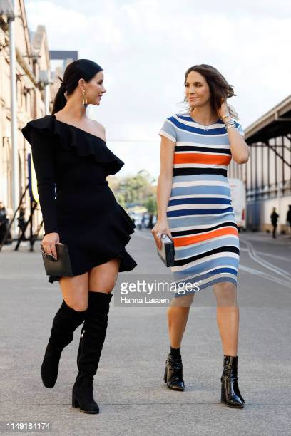 Brittany Hockley wearing Thurley dress and ToniMay earrings and Laura Byrne wearing By Johnny dress and ToniMay bracelets at MercedesBenz Fashion...