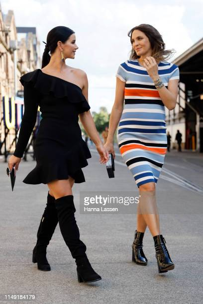 Brittany Hockley wearing Thurley dress and ToniMay earrings and Laura Byrne wearing By Johnny dress and ToniMay bracelets at Mercedes-Benz Fashion...
