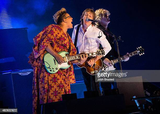 Brittany Howard joins Paul McCartney on stage at the 2015 Lollapalooza music festival at Grant Park on July 31 2015 in Chicago Illinois