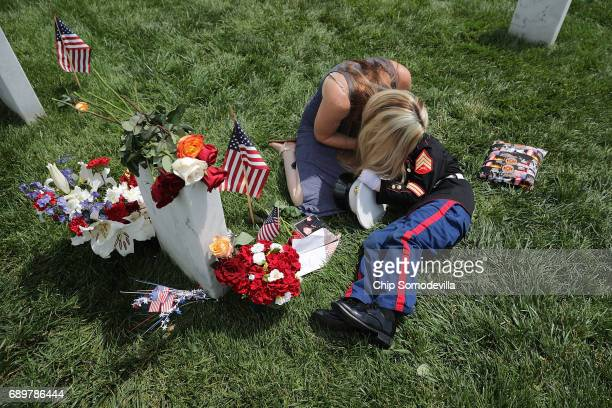 Brittany Jacobs of Hertford North Carolina embraces her son Christian Jacobs while sitting next to the grave of her husband US Marine Corps Sgt Chris...