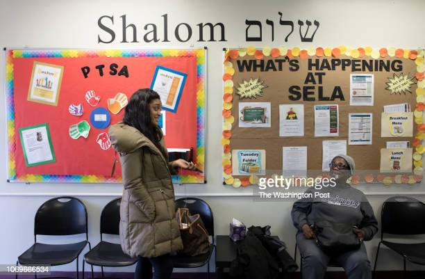 Brittany Johnson a mom of a Sela student and Denise Lockett a grandmother of a Sela student talk in the lobby at Sela the only Hebrew language...