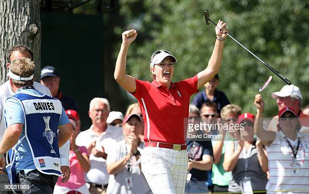 Brittany Laing of the USA celebrates her win over Laura Davies of England at the 18th hole during the Sunday singles matches at the 2009 Solheim Cup...