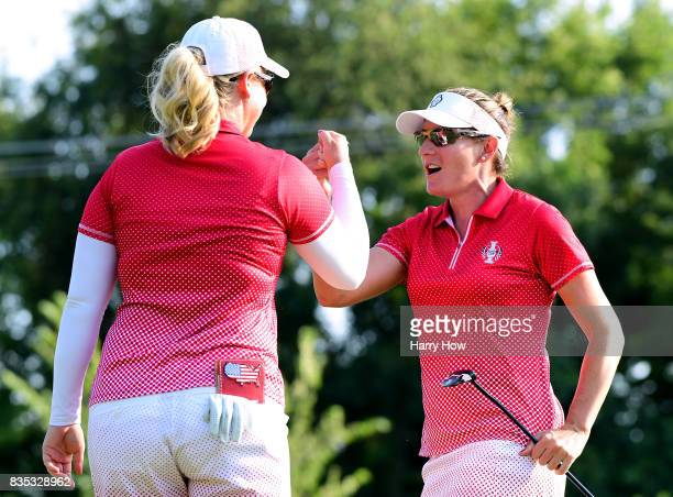 Brittany Lang of Team USA celebrates her birdie putt with Brittany Lincicome to win the 14th hole during the afternoon fourball matches of the...