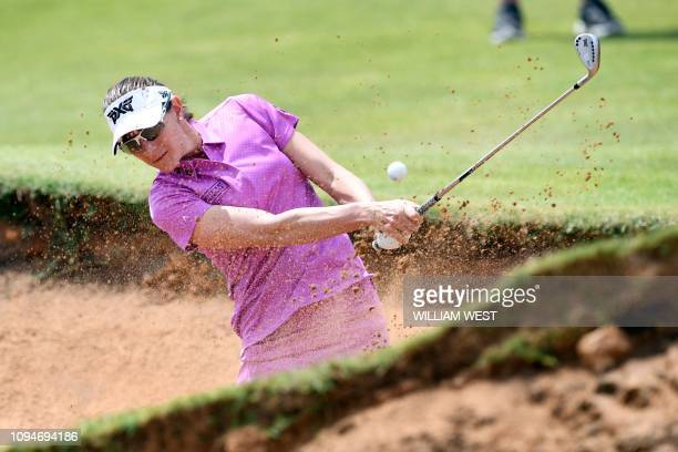Brittany Lang of the US hits out of a bunker during the first round of the Vic Open golf tournament at the 13th Beach Golf Links at Barwon Heads near...