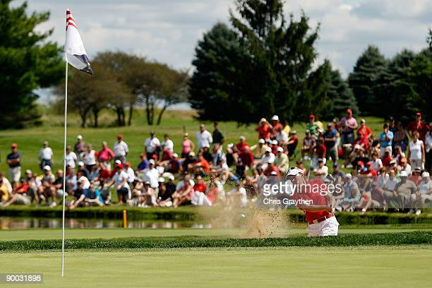 Brittany Lang of the US Team tees chips out of a bunker on the 15th hole during the 2009 Solheim Cup at Rich Harvest Farms on August 23 2009 in Sugar...