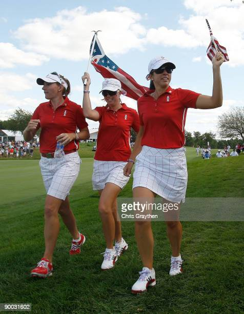 Brittany Lang Paula Creamer and Nicole Castrale of the US Team run up the 17th hole during the Sunday singles matches at the 2009 Solheim Cup at Rich...