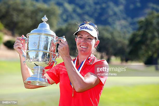 Brittany Lang poses with the trophy on the 18th green after defeating Anna Nordqvist of Sweden in a three hole playoff to win the US Women's Open at...