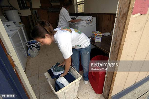 Brittany Lee of Bay St Louis MS finishes her turn at the laundry facilities at a FEMA trailer park November 14 2005 in Kiln Mississippi The trailer...