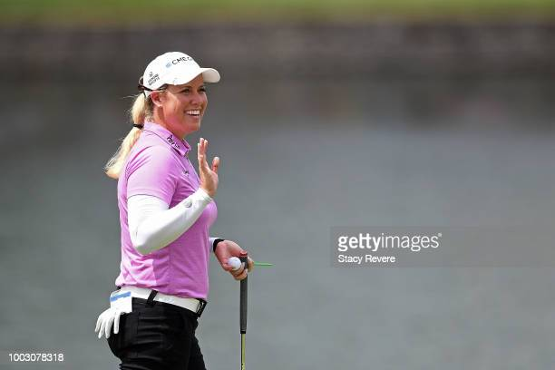 Brittany Licicome waves to the crowd following an eagle on the 17th hole during a continuation of the second round of the Barbasol Championship at...