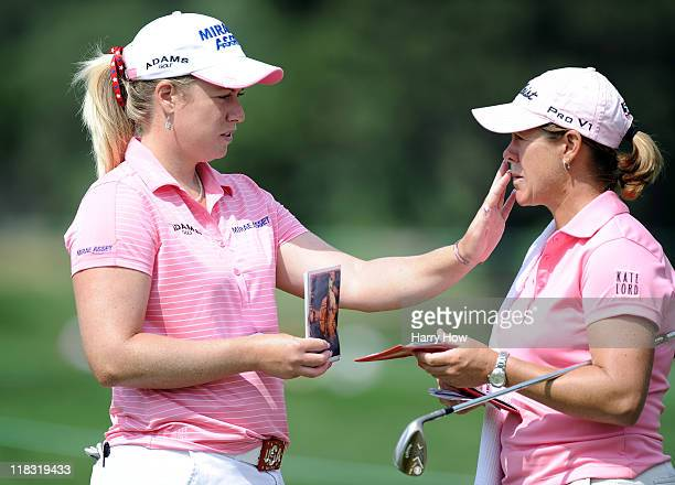 Brittany Lincicome and caddie AJ Eathorne on the 16th green during the practice round for the 2011 US Women's Open at The Broadmoor on July 6 2011 in...