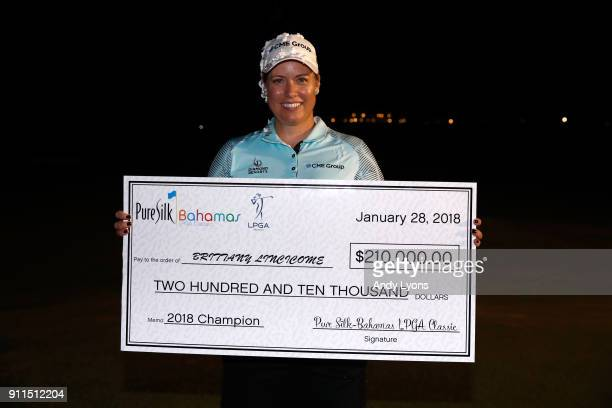 Brittany Lincicome holds the winner's check after winning the Pure Silk Bahamas LPGA Classic at the Ocean Golf Course on January 28 2018 in Paradise...