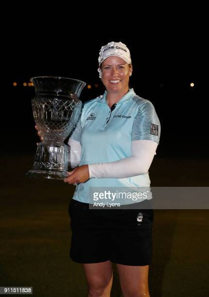 Brittany Lincicome holds the winner's trophy after winning the Pure Silk Bahamas LPGA Classic at the Ocean Golf Course on January 28 2018 in Paradise...