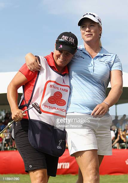 Brittany Lincicome hugs her caddie AJ Eathorne after the final round of the LPGA State Farm Classic at Panther Creek Country Club on June 12 2011 in...