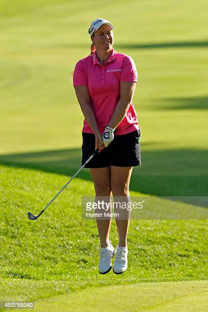 Brittany Lincicome jumps in the air after her chip for eagle just misses going in on the 14th hole during the final round of the Wegmans LPGA...