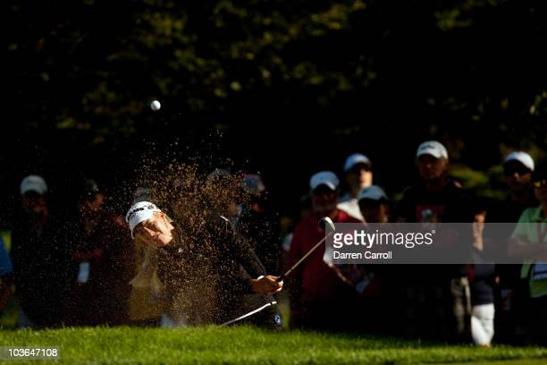 Brittany Lincicome of the United States follows through on a bunker shot during the first round of the CN Canadian Women's Open at St Charles Country...