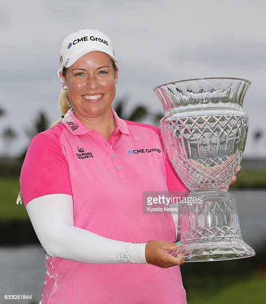 Brittany Lincicome of the United States holds the winner's trophy for the seasonopening Pure SilkBahamas LPGA Classic at Ocean Club Golf Course in...