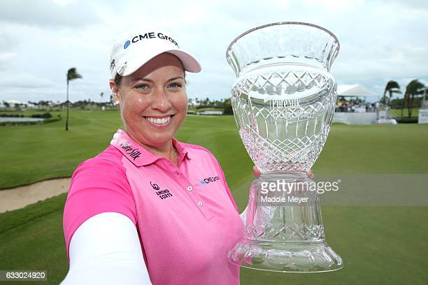Brittany Lincicome of the United States imitates taking a 'selfie' with the trophy on the eighteenth green after the final round of the Pure Silk...