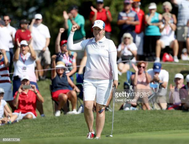 Brittany Lincicome of the United States makes a birdie putt at the par 3 14th hole in her match with Brittany Lang against Melissa Reid and Carlota...