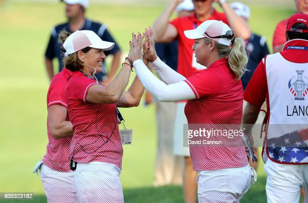 Brittany Lincicome of the United States Team is congratulated by her team captain Juli Inkster after winning her match with Brittany Lang against...