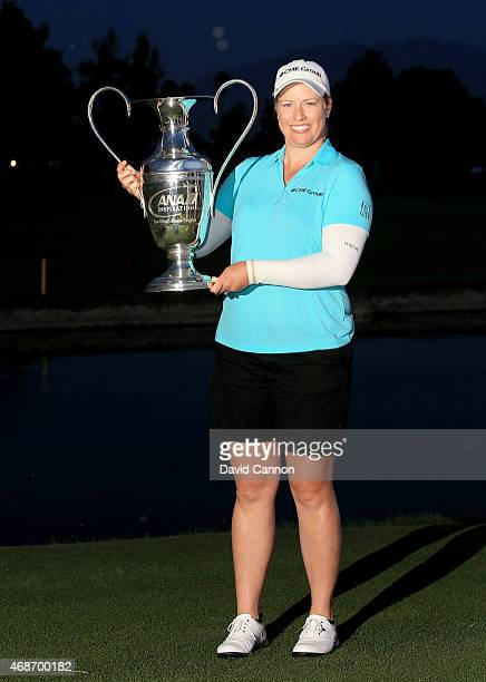 Brittany Lincicome of the USA holds the trophy after her playoff win in the final round of the ANA Inspiration on the Dinah Shore Tournament Course...