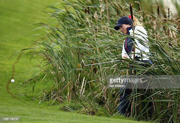 Brittany Lincicome of the USA plays from the reeds on the 6th hole during the morning foursomes on day one of the 2011 Solheim Cup at Killeen Castle...