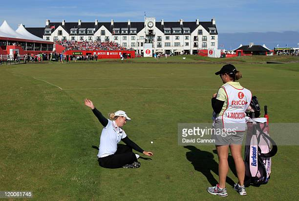 Brittany Lincicome of the USA waits on the 18th hole with her caddie AJ Eathorne during the second round of the 2011 Ricoh Women's British Open at...