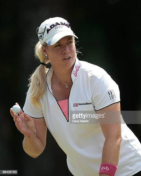 Brittany Lincicome waves after making her putt on the ninth hole during second round play in the Bell Micro LPGA Classic at the Magnolia Grove Golf...