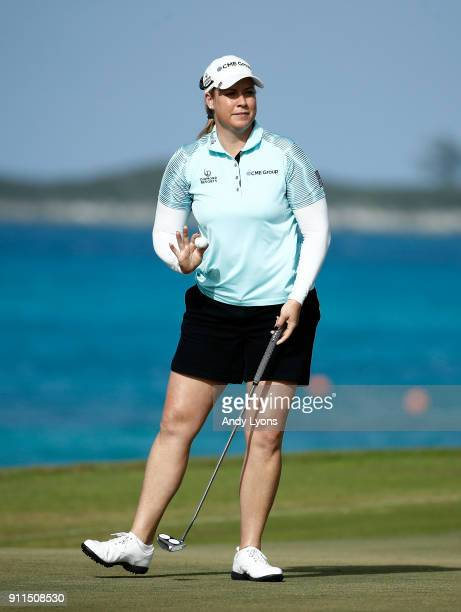 Brittany Lincicome waves to the crowd after making birdie on the 8th hole during the final round of the Pure Silk Bahamas LPGA Classic at the Ocean...