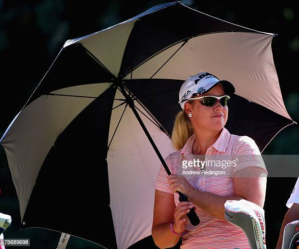 Brittany Lincicone of USA uses a parasol to shelter from the sun on the 16th hole during the first round of the Evian Masters on July 26 2007 in...