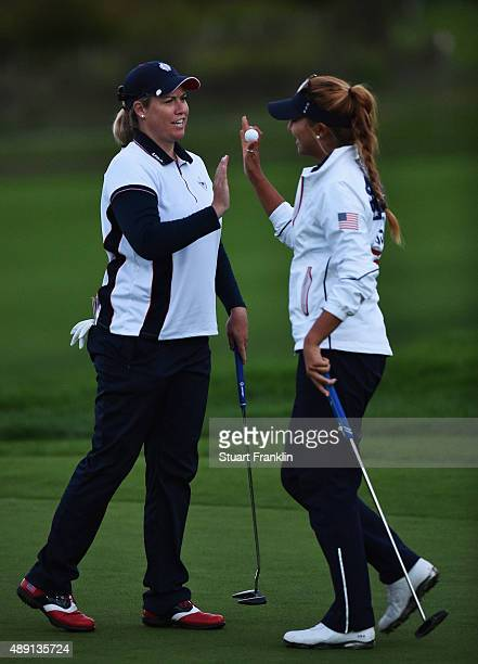 Brittany Linicome and Alison Lee of team USA high five during the afternoon fourball matches at The Solheim Cup at St LeonRot Golf Club on September...