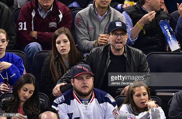 Brittany Lopez and Christian Slater attend the Washington Capitals vs New York Rangers playoff game at Madison Square Garden on April 30 2015 in New...
