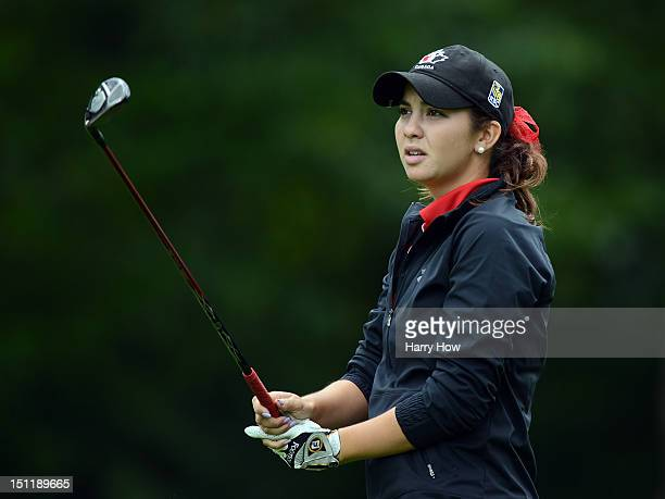Brittany Marchand of Canada reacts to her second shot on the 18th hole during round one of the Canadian Women's Open at The Vancouver Golf Club on...