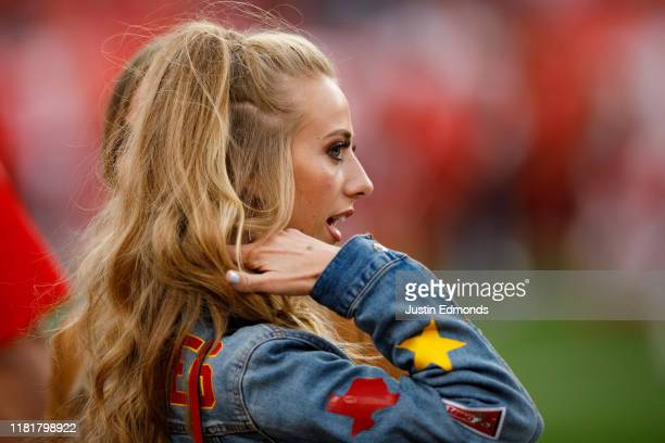 Brittany Matthews girlfriend of quarterback Patrick Mahomes of the Kansas City Chiefs stands on the field before a game against the Denver Broncos at...