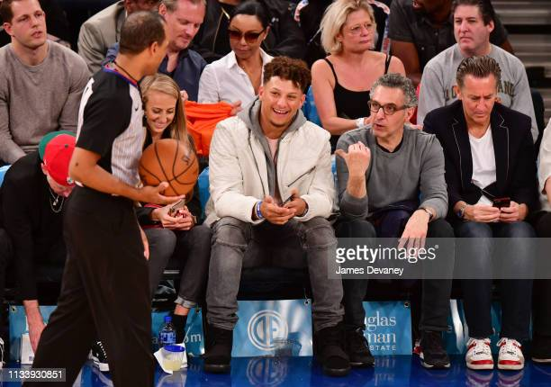 Brittany Matthews Patrick Mahomes and John Turturo attend Miami Heat v New York Knicks game at Madison Square Garden on March 30 2019 in New York City