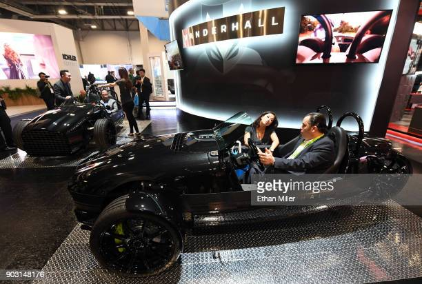 Brittany Murata of the Vanderhall Motor Works shows a Vanderhall Edison2 threewheeled autocycle to Shaher Iswail during CES 2018 at the Sands Expo...
