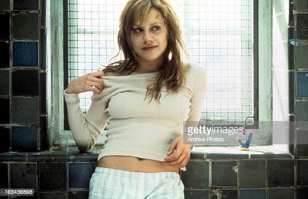 Brittany Murphy leaning next to window in a scene from the film 'Don't Say A Word' 2001