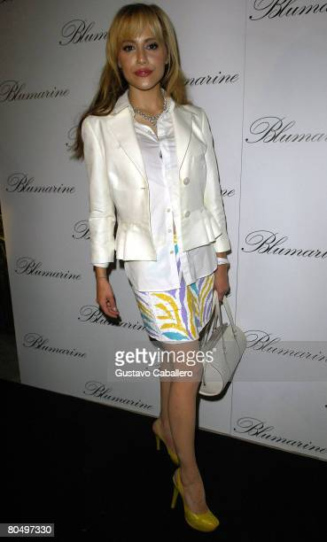 Brittany Murphy poses at the opening of the Blumarine flagship store in the United States at the Village of Merrick Park on April 2, 2008 in Coral...
