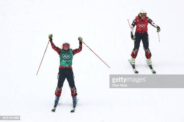 Brittany Phelan of Canada celebrates from Kelsey Serwa of Canada during the Freestyle Skiing Ladies' Ski Cross Semifinals on day fourteen of the...