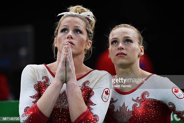 Brittany Rogers and Elsabeth Black of Canada react after failing to qualify for the team final during Women's qualification for Artistic Gymnastics...