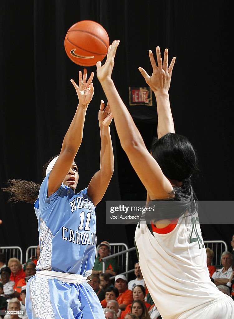Brittany Rountree #11 of the North Carolina Tar Heels shoots the ball over Shawnice Wilson #40 of the Miami Hurricanes on January 27, 2013 at the BankUnited Center in Coral Gables, Florida. The Tar heels defeated the hurricanes 64-62.