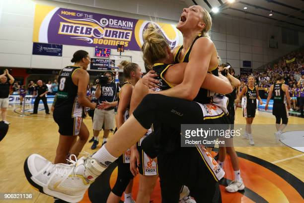 Brittany Smart and Maddie Garrick of the Melbourne Boomers celebrate after they defeated the Fire during game two of the WNBL Grand Final series...