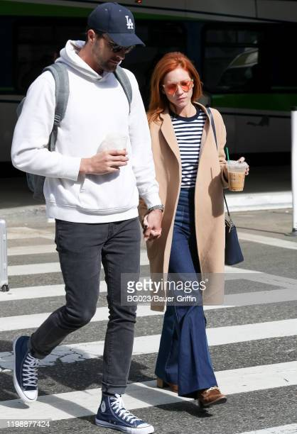 Brittany Snow and her fiance Tyler Stanaland are seen at LAX airport on February 05, 2020 in Los Angeles, California.