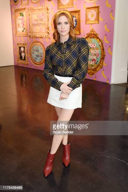 Brittany Snow visits the artist in residence Ashley Longshore installation during New York Fashion Week The Shows at Spring Studios on September 09...