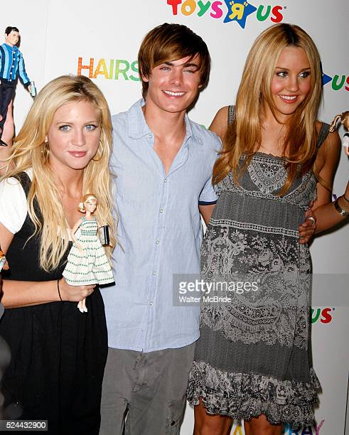 Brittany Snow Zac Efron and Amanda Bynes of the HAIRSPRAY movie helps raise the curtain on the new Doll Line at Toys R Us in Times Square New York...
