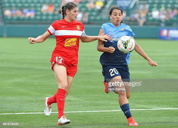 Brittany Taylor of the Western New York Flash and Samantha Kerr of the Sky Blue FC battle for a loose ball during the second half at Sahlen's Stadium...