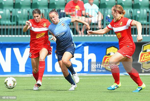 Brittany Taylor of the Western New York Flash Caitlin Foord of the Sky Blue FC and Ashley Nick of the Western New York Flash battle for a loose ball...