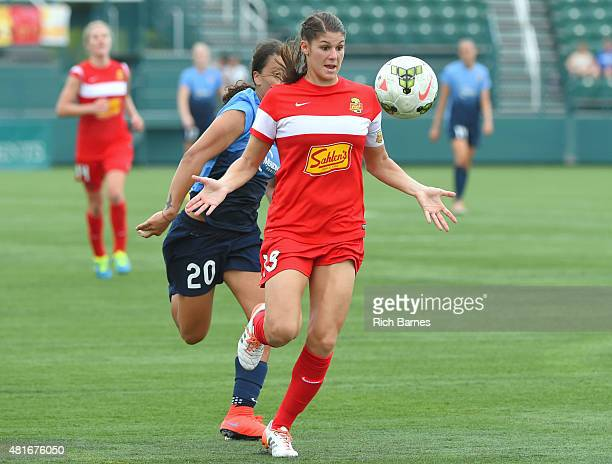Brittany Taylor of the Western New York Flash tracks a loose ball in front of Samantha Kerr of the Sky Blue FC during the second half at Sahlen's...