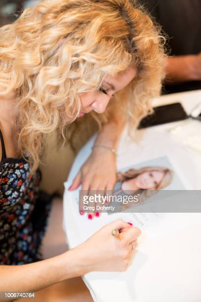 Brittany Underwood signs autographs at The Bay Cast Host Fan Appreciation Event on July 27 2018 in Glendale California