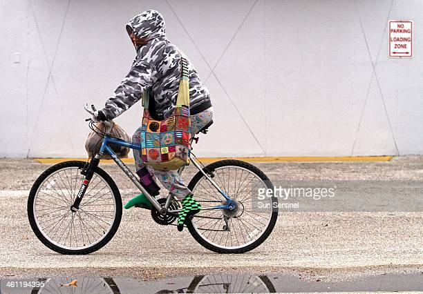 Brittany Woodside rides her bicycle in Oakland Park Fla on her way to Pompano Beach on Tuesday Jan 7 2014 I'm freezing and I'm wearing three jackets...